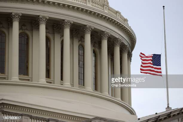 The U.S. Flag flies at half-staff over the Capitol Building in honor of the victims of a mass shooting this week in Georgia on March 19, 2021 in...