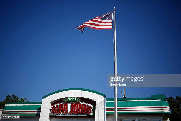 The US flag flies outside of a Papa John's International Inc restaurant in Louisville Kentucky US on Friday May 1 2015 Papa John's is expected...