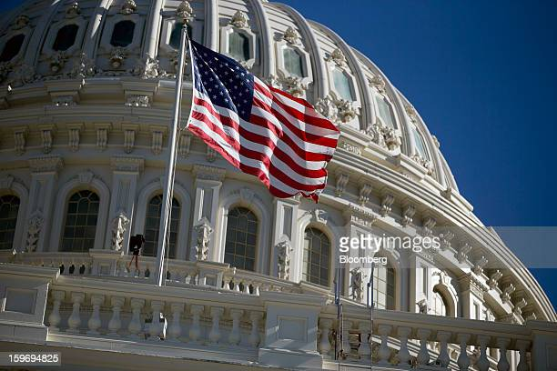 The US flag flies outside of the US Capitol prior to the second inauguration of US President Barack Obama in Washington DC US on Friday Jan 18 2013...