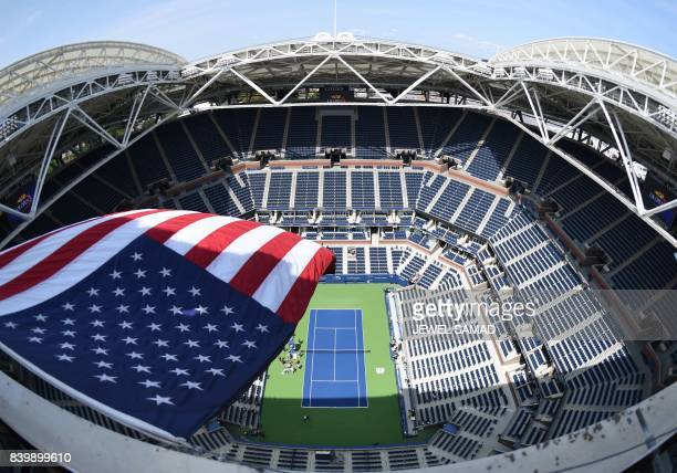 The US flag flies over Arthur Ashe Stadium August 27 2017 at the National Tennis Center in New York Tournament play in the 2017 US Open is set to...