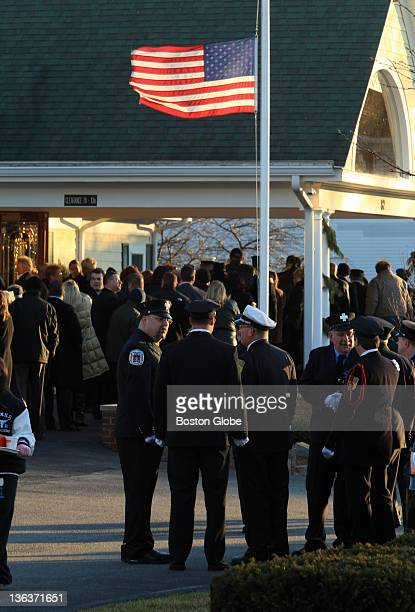 The US flag flying at half mast during the wake of fallen Peabody firefighter James M Rice at the Conway CahillBrodeur Funeral Home in Peabody on Dec