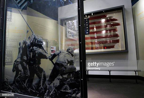 The US flag from the famous World War II photograph taken at Iwo Jima sits in a display case opposite a reproduction of the photograph at the new...