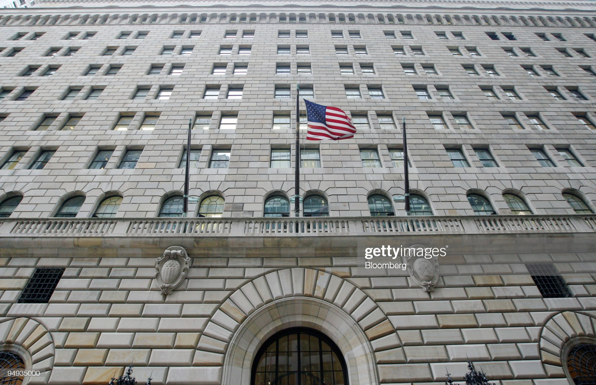 The U.S. flag hangs on the facade of the Federal Reserve Ban : News Photo