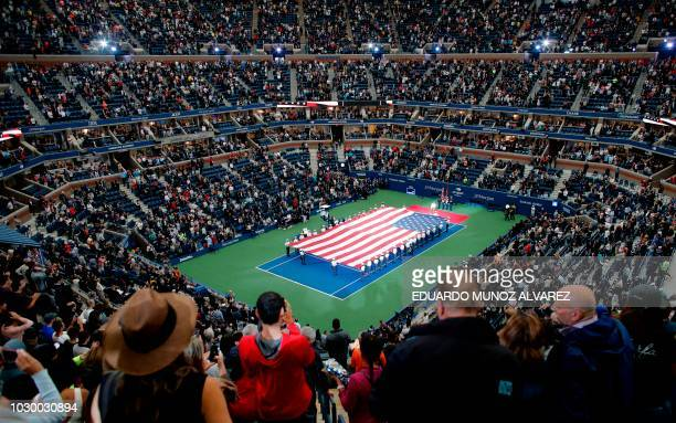 The US flag is displayed before Novak Djokovic of Serbia battles Juan Martin del Potro of Argentina in their 2018 US Open men's singles final match...