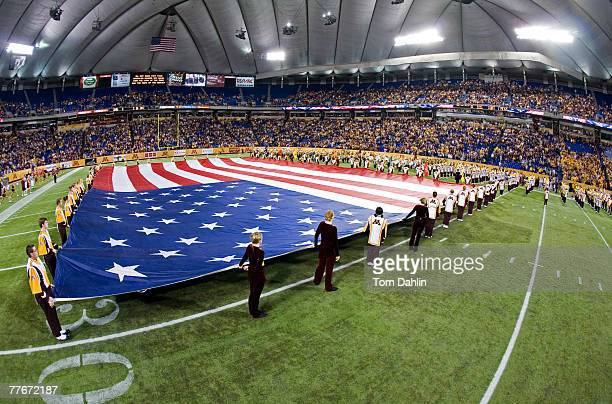 The U.S. Flag is displayed during the national anthem prior to an NCAA game pitting the Minnesota Golden Gophers against the Illinois Fighting Illini...
