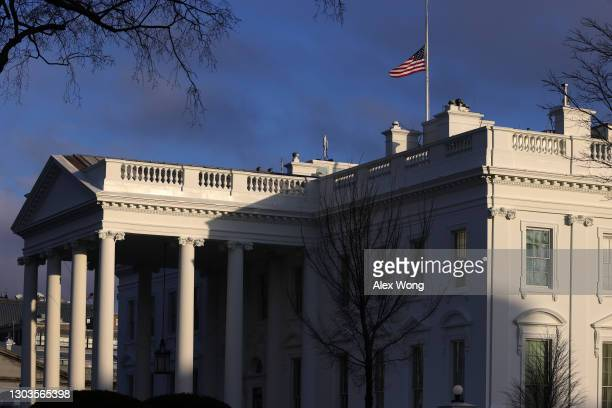 The U.S. Flag is flied at half-staff on the roof of the White House to honor lives that have been lost to COVID-19 February 22, 2021 in Washington,...