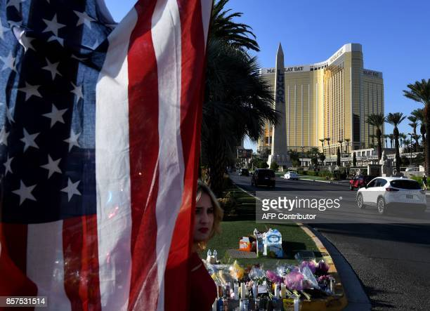 TOPSHOT The US flag is left at a makeshift memorial outside the Route 91 music festival site beside the Mandalay Hotel October 4 2017 on the Las...