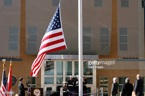 The US flag is raised during a formal dedication ceremony attended by the Iraqi President Jalal Talabani, at the new US embassy amid heavy security,...
