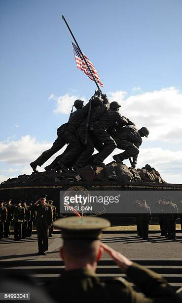 The US flag is raised over the Marine Corps Memorial in Arlington Virginia on February 23 2009 during an event honoring veterans of the Battle of Iwo...