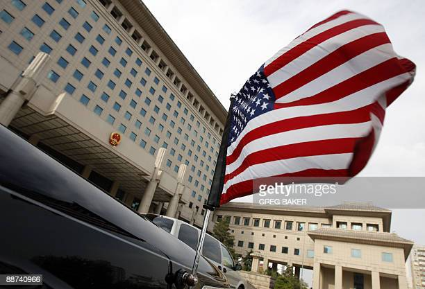 The US flag is seen on an embassy car outside China's Ministry of Defense as US Department of Defense Under Secretary Michele Flournoy and Chinese...