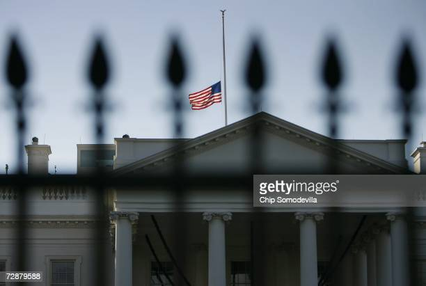 The US flag over the White House flies at halfstaff to honor former US President Gerald R Ford December 27 2006 in Washington DC Ford the nation's...