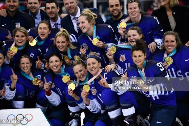 TOPSHOT The US gold medal team poses after the medal ceremony after the women's ice hockey event during the Pyeongchang 2018 Winter Olympic Games at...