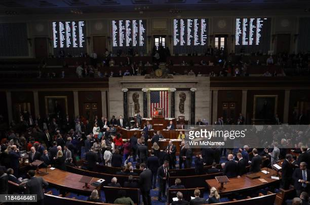 The US House of Representatives votes on a resolution formalizing the impeachment inquiry centered on US President Donald Trump October 31 2019 in...