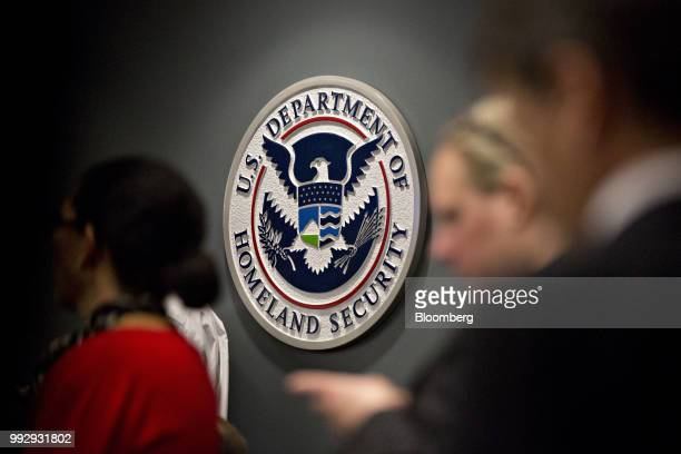 The US Immigration and Customs Enforcement seal hangs on a wall before a speech by US Vice President Mike Pence not pictured at the agency...