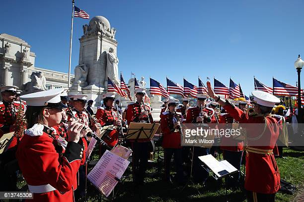 The US Marine Corp Band performs during a Columbus Day ceremony at the National Columbus Memorial in front of Union Station October 10 2016 in...