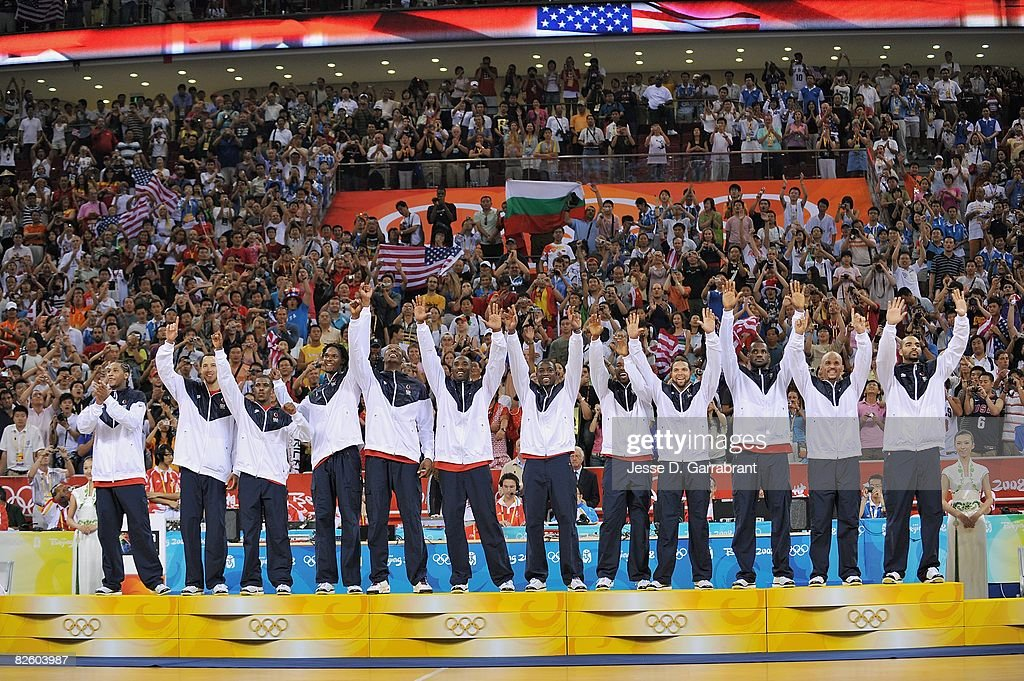 The U.S. Men's Senior National Team celebrates winning the men's gold medal on the podium at the 2008 Beijing Summer Olympics at the Beijing Olympic Basketball Gymnasium on August 24, 2008 in Beijing, China. The United States defeated Spain 118-107 to take the men's gold medal.
