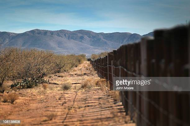 The US Mexico border fence stretches through the Sonoran Desert on January 18 2011 in the Tohono O'odham Nation Arizona The Native American...