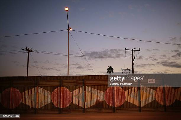 The US Mexico border wall stands on November 19 2014 in Calexico California US President Barack Obama plans to announce executive action on...