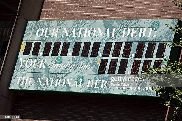 The US National Debt Clock billboard is displayed on a building on Sixth Ave in midtown Manhattan on July 11 2011 in the New York City The national...