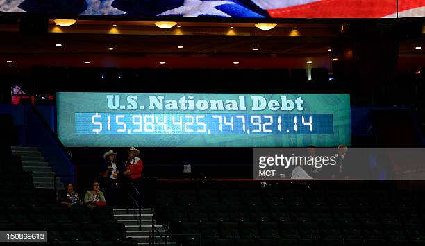 The US National Debt clock is seen at the second session of the 2012 Republican National Convention at the Tampa Bay Times Forum in Tampa Tuesday...