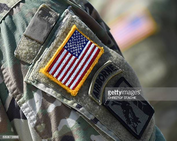 The US national emblem is seen on the uniform of a US soldier at the training area in Grafenwoehr near Eschenbach southern Germany on May 11 during...