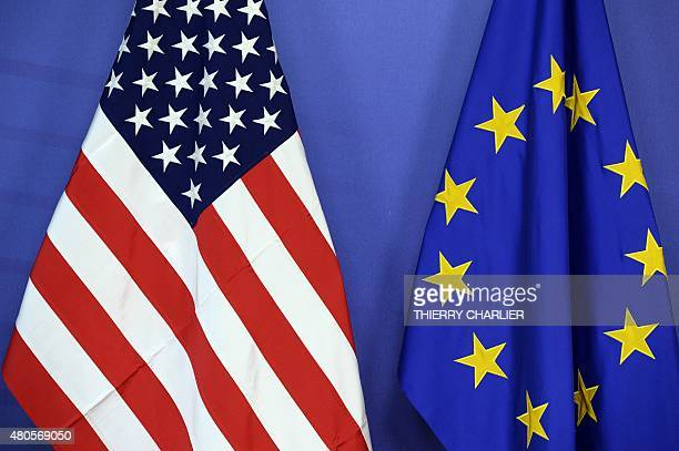 The US national flag and the flag of the European Union are placed sidebyside during the Transatlantic Trade and Investment Partnership meeting at...