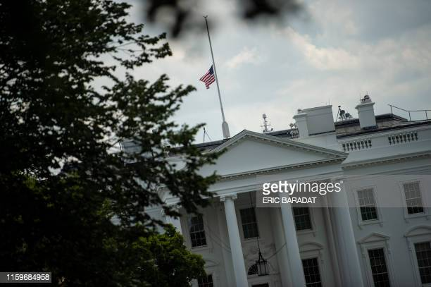 The US national flag flies at halfmast following the recent mass shooting in El Paso and Dayton on August 4 2019 in WashingtonDC US President Donald...