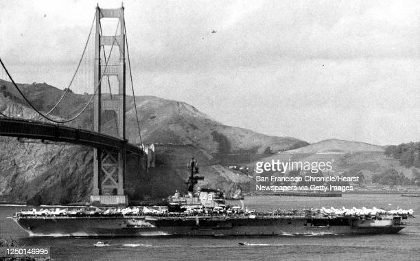 The U.S. Navy aircraft carrier Coral Sea arrives, passing under the Golden Gate Bridge, November 12, 1971.