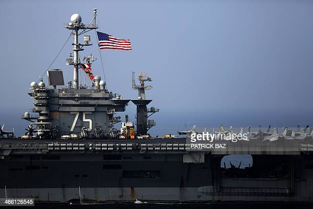 The US Navy aircraft carrier USS Harry STrumann sails in the Gulf of Oman on January 31 2014 French aircraft carrier Charles de Gaulle and the USS...