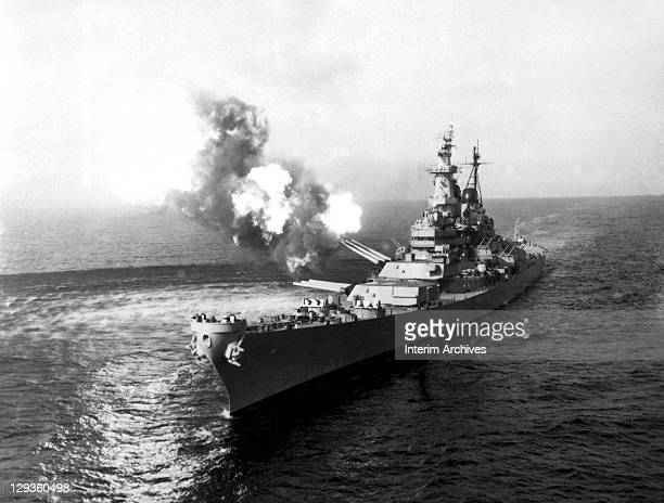 The US Navy battleship USS Missouri fires a salvo from its 16 inch guns towards Chongjin in an effort to cut North Korean communication lines October...