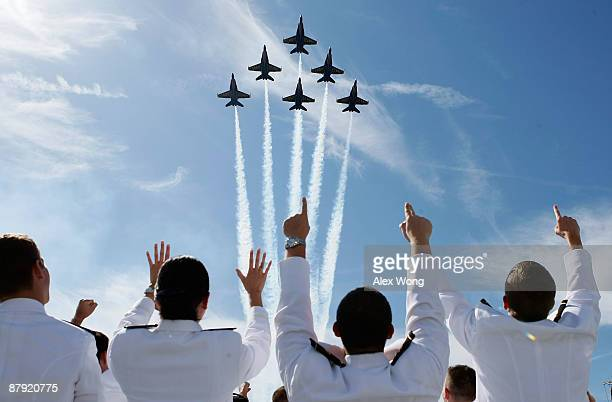 The US Navy Blue Angels aerobatic team flies over the United States Naval Academy Graduation and Commissioning Ceremony at the NavyMarine Corps...