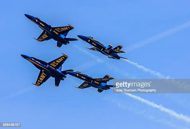 The US Navy Blue Angels F/A 18 Hornets fly over the Severn River performing for hundreds of onlookers at the United States Naval Academy during...