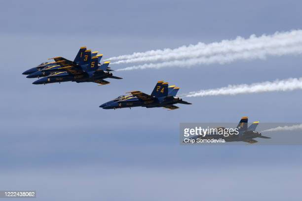 The US Navy Blue Angels fly across the nation's capital during a tribute to healthcare workers first responders members of the military and other...