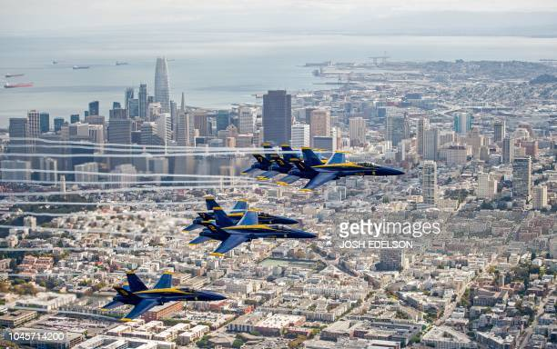 TOPSHOT The US Navy Blue Angels fly over San Francisco California as part of a practice run for Fleet Week on October 04 2018