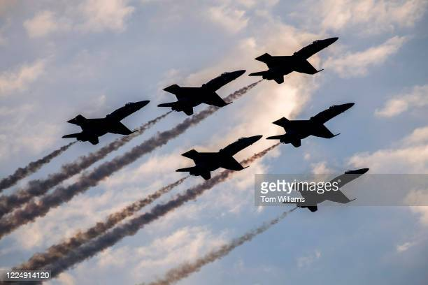 The U.S. Navy Blue Angels fly over Washington, D.C., as part of the Salute to America celebration on Saturday, July 4, 2020.