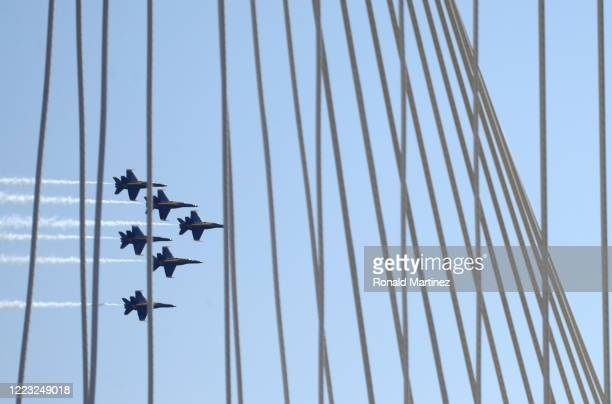 The U.S. Navy Blue Angels flyover the Margaret Hunt Hill Bridge in downtown Dallas to honor healthcare, frontline and essential workers on May 06,...
