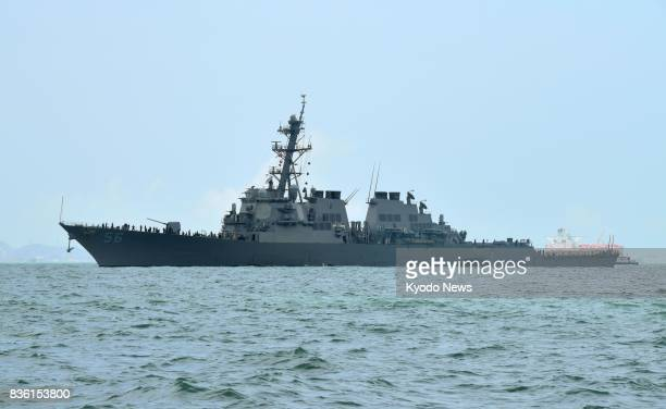 The US Navy destroyer John S McCain sails to Changi Naval Base in Singapore on Aug 21 after colliding with an oil tanker east of Singapore and the...