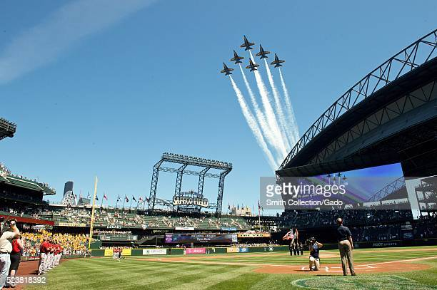 The US Navy Flight Demonstration Squadron the Blue Angels fly over Safeco Field before a Seattle Mariners baseball game Seattle Image courtesy Mass...