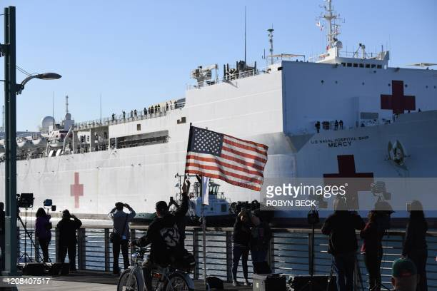 The US Navy hospital ship Mercy arrives March 27 2020 at the Port of Los Angeles to help local hospitals amid the growing coronavirus crisis in Los...