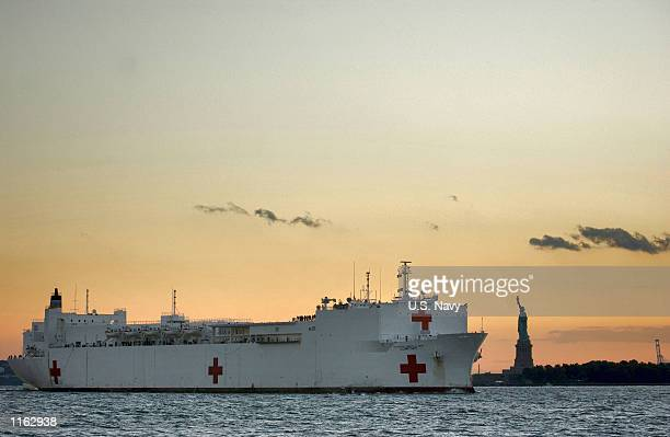 The US Navy hospital ship USNS Comfort passes the Statue of Liberty September 15 2001 enroute to Manhattan to provide assistance to victims of the...