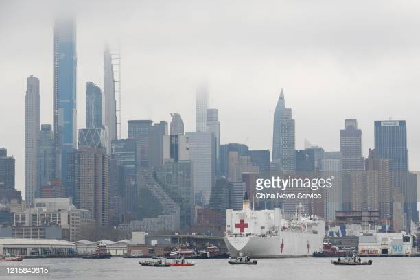 The US Navy Ship Comfort arrives at Pier 90 in Manhattan on March 30 2020 in New York City The Comfort a floating hospital in the form of a Navy ship...