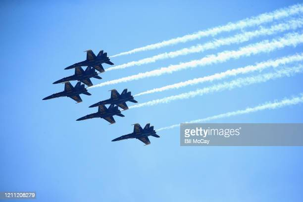 The US Navy's Blue Angels and Air Force's Thunderbirds fly over the city to honor COVID19 frontline workers on April 28 2020 in Philadelphia...