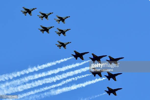 The US Navy's Blue Angels and US Air Force's Thunderbirds perform a flyover tribute to honor NYC COVID19 frontline workers on April 28 2020 as seen...