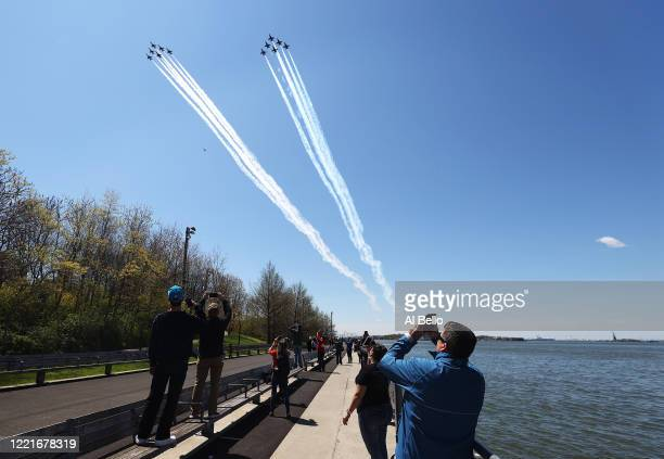 The US Navy's Blue Angels and US Air Force's Thunderbirds perform a flyover across Brooklyn Bridge park as a tribute to honor NYC COVID19 frontline...