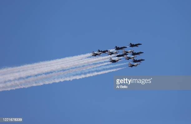 The US Navy's Blue Angels and US Air Force's Thunderbirds perform a flyover tribute to honor NYC COVID19 frontline workers on April 28 2020 in the...