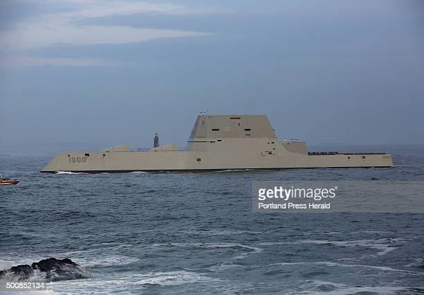 The US Navys new stealth destroyer the USS Zumwalt passes Fort Williams State Park with Ram Island Ledge Lighthouse in the background on its way to...