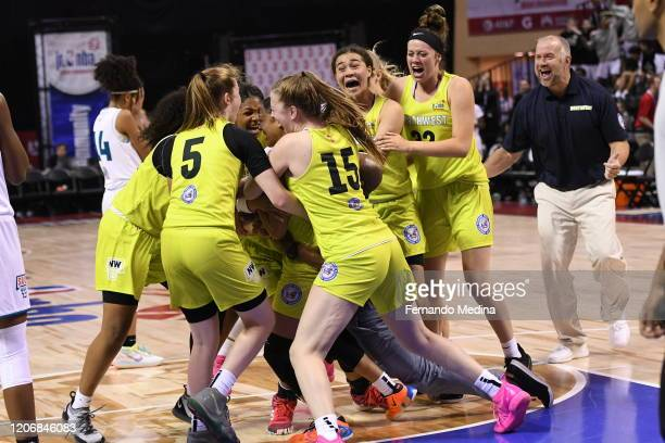 The U.S. Northwest Girls reacts to Monique Carter of the U.S. Northwest Girls buzzer beater to give them the win against the U.S. South Girls during...