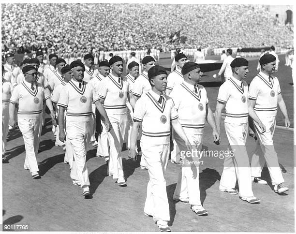 The US Olympic team marches in berets during the Opening Ceremony of the 1932 Summer Olympics at the Los Angeles Memorial Coliseum on July 30 1932 in...