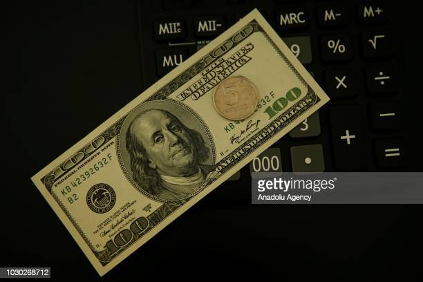 The US one hundred dollar bill and Russian 5 rouble coins are seen Moscow Russia on September 07 2018