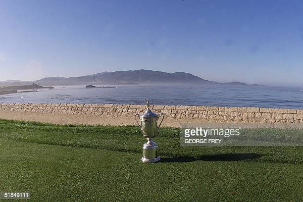 The US Open championship trophy stands alone at the edge of the 18th green at Pebble Beach, California to pay tribute to US golfer Payne Stewart who...
